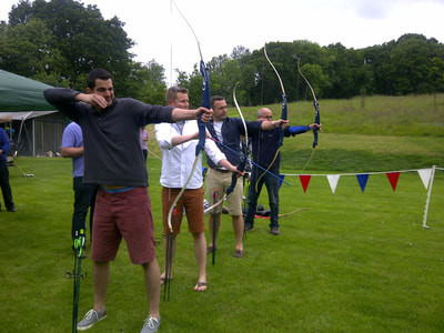 boys aiming bows