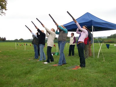 laser clay shooting girls